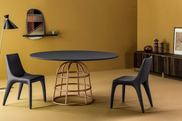 Gilles's Modern Dining Tables Rest On Wireframe-style Metal Bases | #diningtables #diningroom #thediningroom #diningarea #diningareadesign #roomdesign #diningdesign #exclusivedesign #interiordesign #product design #luxurybrands @moderndiningtables