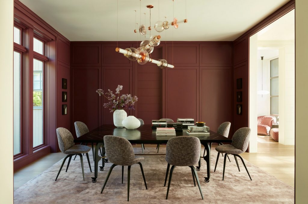 Meet a Modern Home With A Striking Pink Sculpture and a Purple Dining Room